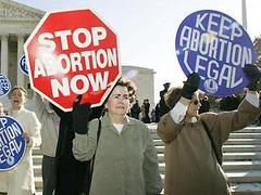 Abortion protest signs: pro-life and pro-choice side-by-side